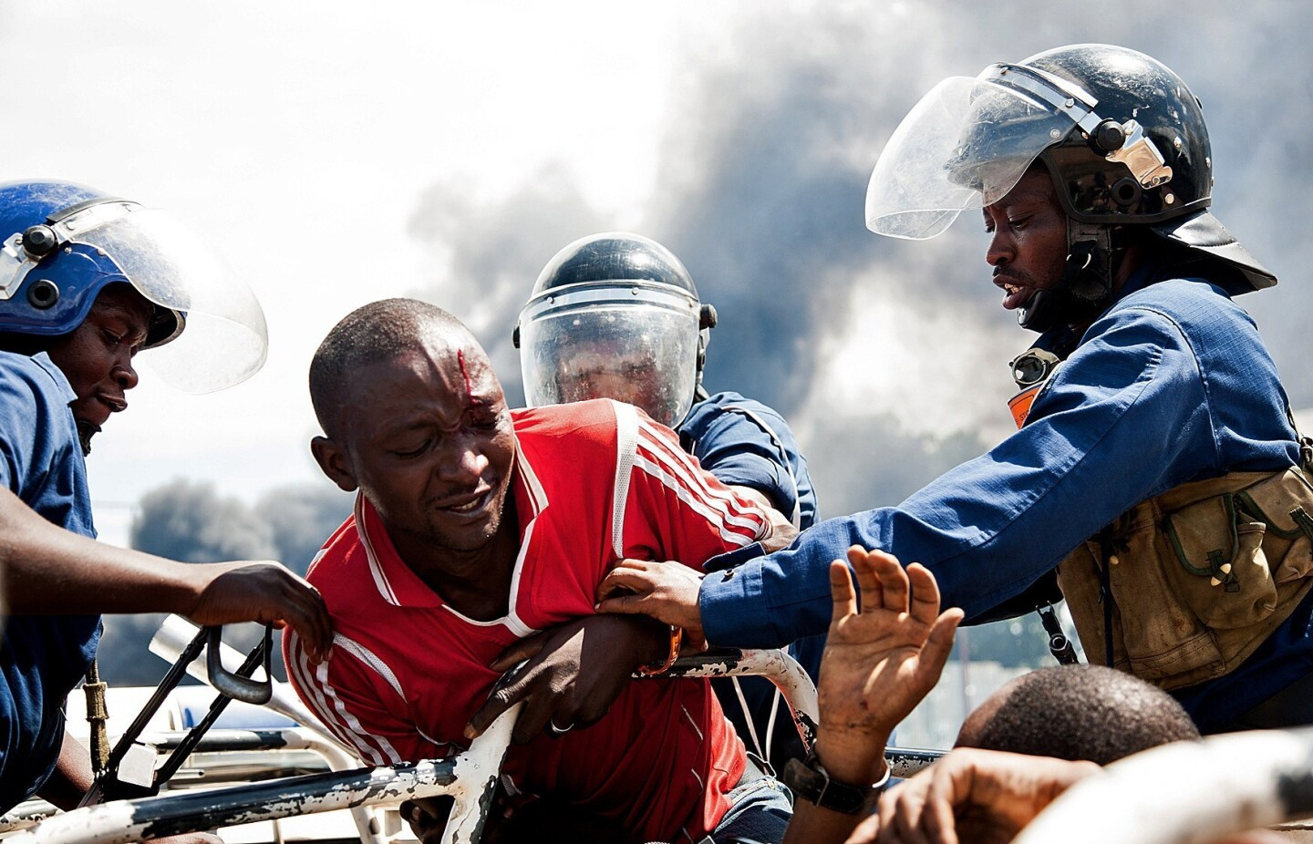 A man is lifted by police during a protest in Bujumbura. A top Burundian general announced the overthrow of President Pierre Nkurunziza, following weeks of violent protests against the president's bid to stand for a third term. Nkurunziza asserted he remained in charge.