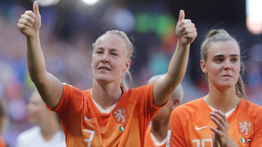 The Netherlands' Stefanie Van Der Gragt, left, and Jill Roord acknowledge Dutch fans after defeating Italy 2-0 in a Women's World Cup quarterfinal on Saturday.