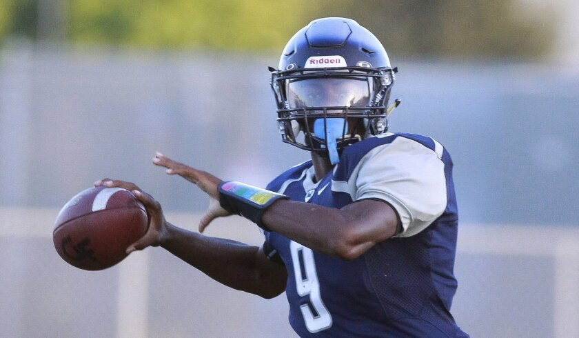 Madison quarterback Terrell Carter threw five touchdown passes against Steele Canyon.