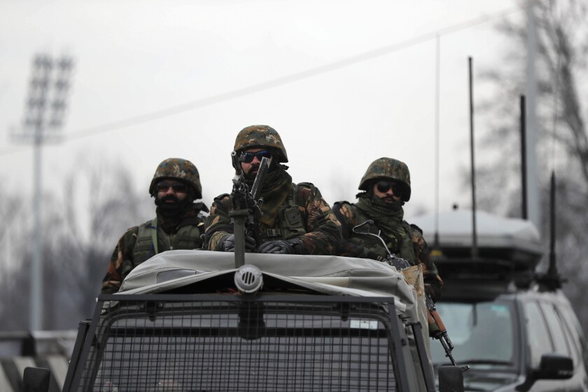 Indian army soldiers guard on top of their armored vehicle as a convoy of New Delhi-based diplomats passes through Srinagar, Indian controlled Kashmir, Thursday, Jan. 9, 2020. Envoys from 15 countries including the United States are visiting Indian-controlled Kashmir starting Thursday for two days, the first by New Delhi-based diplomats since India stripped the region of its semi-autonomous status and imposed a harsh crackdown in early August. (AP Photo/Mukhtar Khan)