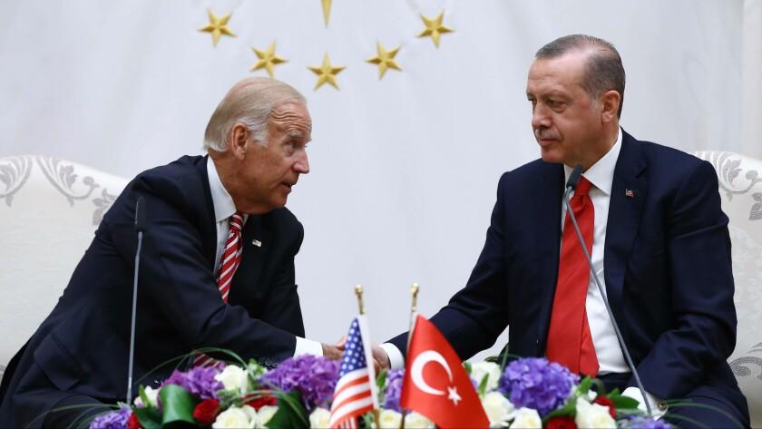 U.S. Vice President Joe Biden, left, and Turkish President Recep Tayyip Erdogan shake hands after a meeting in Ankara, the Turkish capital, on Wednesday, Aug. 24, 2016.