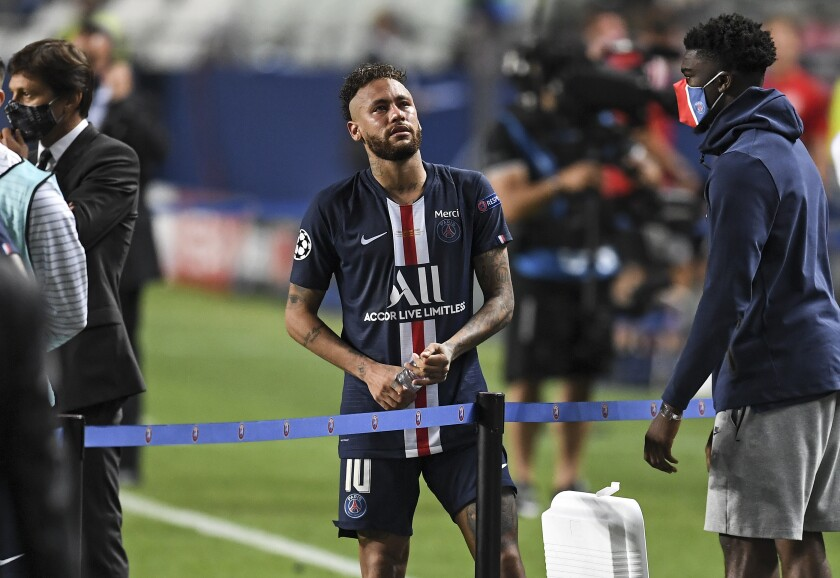 PSG's Neymar stands on the pitch disappointed after losing the Champions League final soccer match between Paris Saint-Germain and Bayern Munich at the Luz stadium in Lisbon, Portugal, Sunday, Aug. 23, 2020. (David Ramos/Pool via AP)