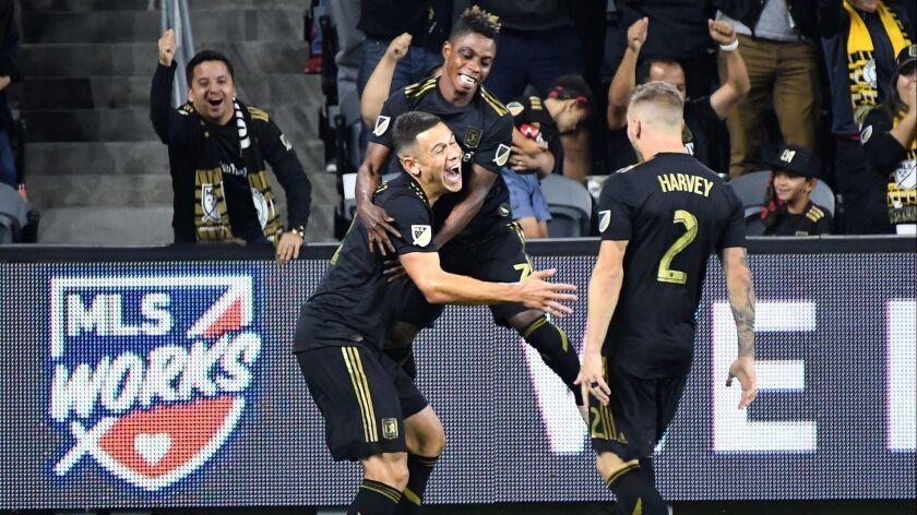 LOS ANGELES, CALIFORNIA , NOVEMBER 1, 2018-LAFC's Christian Ramirez, left, celebrates the go-ahead g
