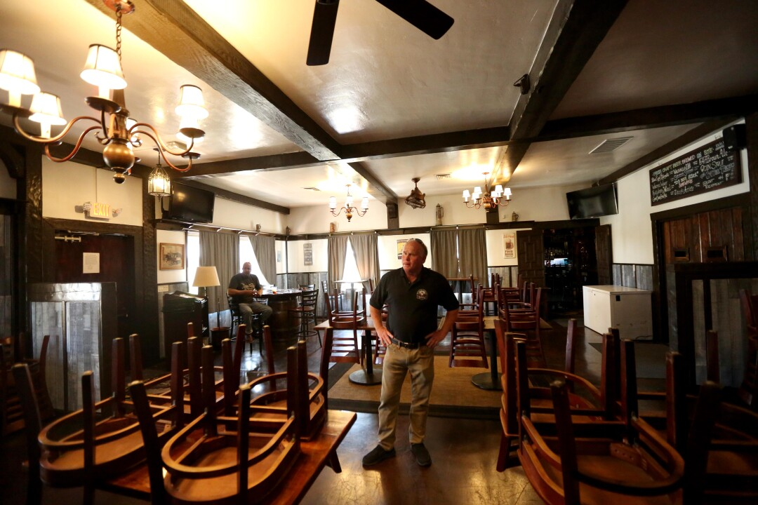 Bill Rodgers, co-owner of Solvang Brewing Co., stands inside the establishment, which has complied with the order that nonessential businesses close.