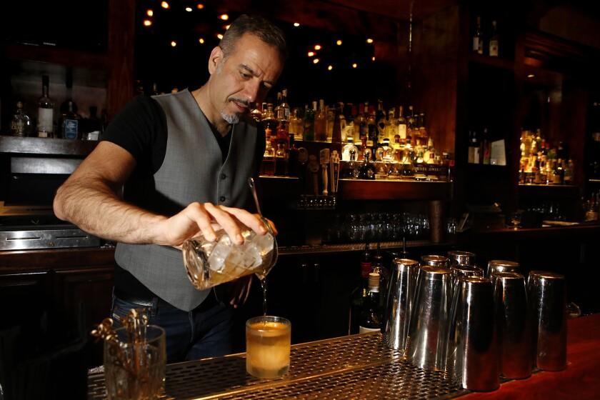 Vincenzo Marianella makes a Smoke of Scotland drink at the Copa d'Oro bar in Santa Monica on April 23, 2015.