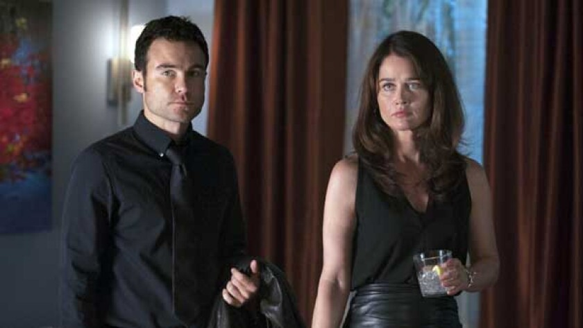 """Robert Belushi and Robin Tunney in """"The Mentalist"""" on CBS."""