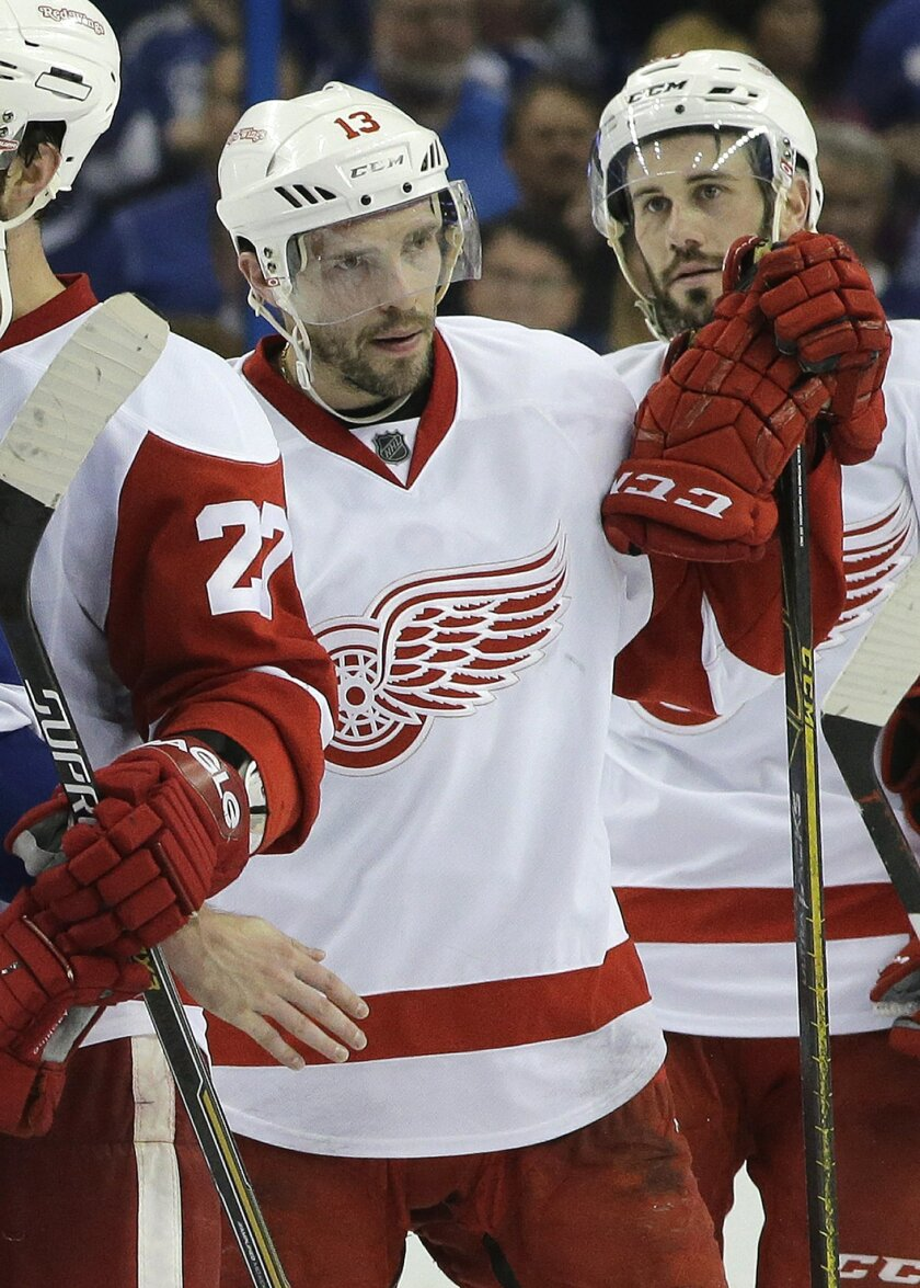 Detroit Red Wings center Pavel Datsyuk (13), of Russia, and left wing Drew Miller wait to shake hands with the Tampa Bay Lightning after the Lightning defeated the Red Wings 2-0 during Game 7 of a first-round NHL Stanley Cup hockey playoff series Wednesday, April 29, 2015, in Tampa, Fla. (AP Photo/