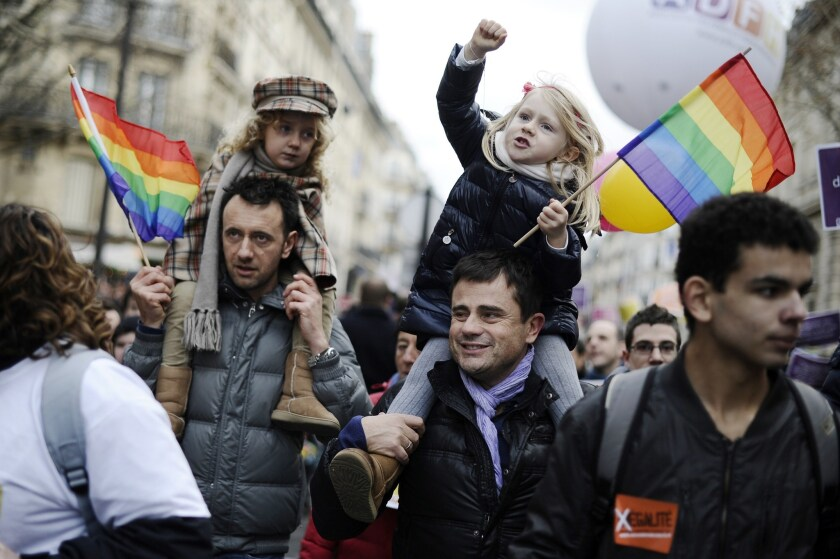 Fathers and daughters at a gay rights demonstration in Paris.