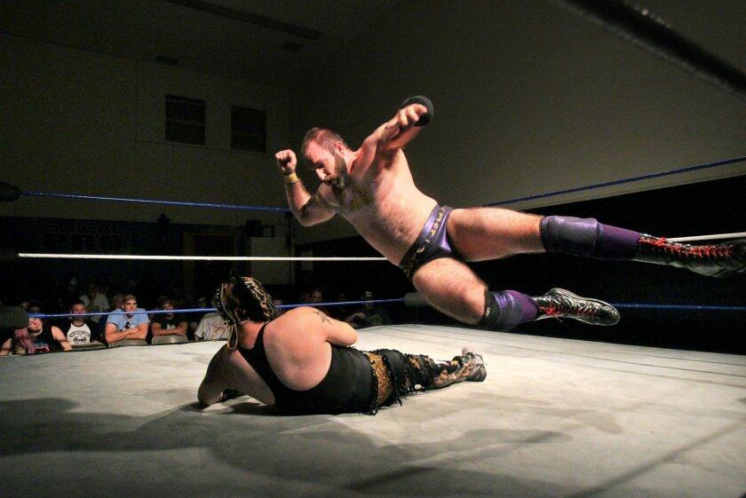 Sasha Darevko jumps on top of opponent Motros Jungle on day 1 of SoCal Pro Wrestling's 2015 Summer Classic event at their Escondido training facility.