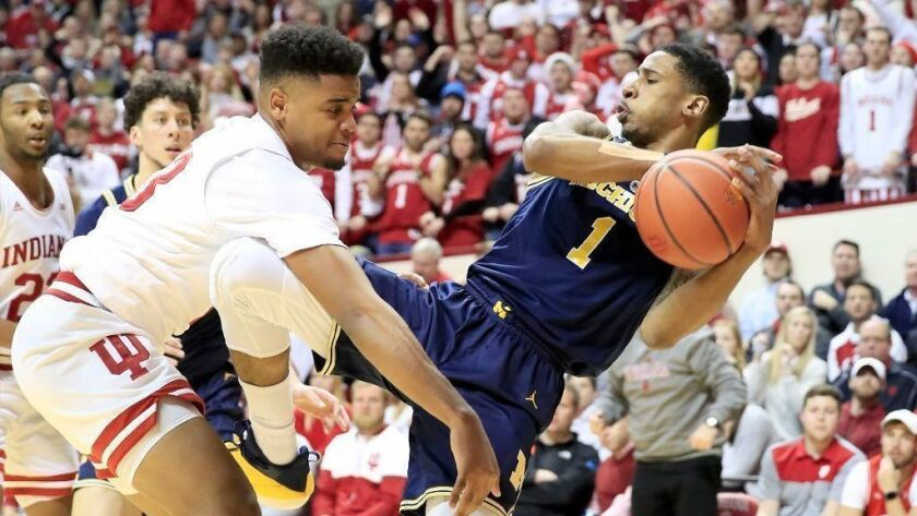 Michigan's Charles Matthews grabs a rebound during Friday's win over Indiana.