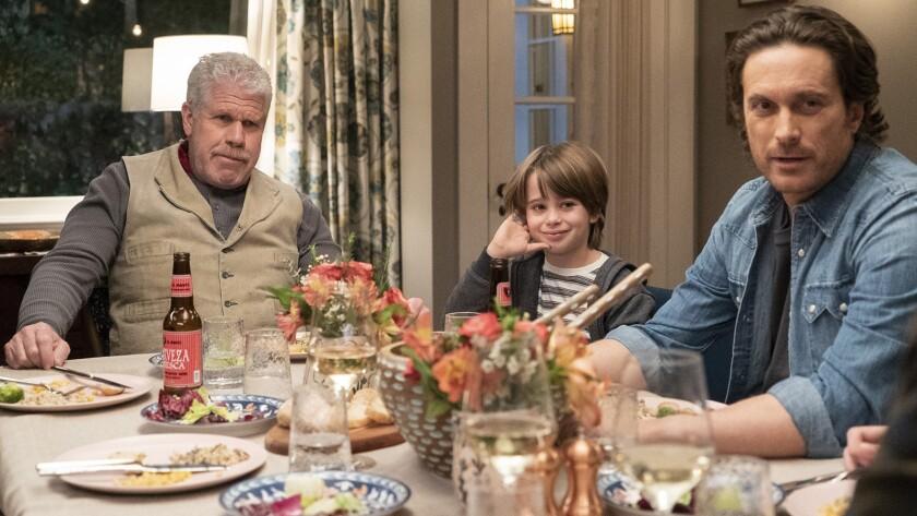 "Ron Perlman, left, Sander Thomas and Oliver Hudson in ""Splitting up Together"" on ABC."