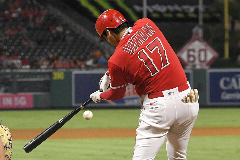 Los Angeles Angels' Shohei Ohtani hits a two-run home run during the sixth inning of a baseball game against the Colorado Rockies Tuesday, July 27, 2021, in Anaheim, Calif. (AP Photo/Mark J. Terrill)