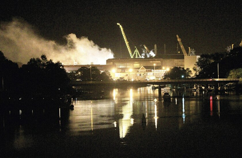 In this  2012 photo, smoke rises from a fire on the USS Miami submarine in Kittery, Maine.