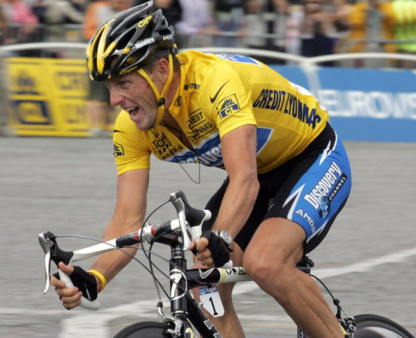 Lance Armstrong rides during the 2005 Tour de France. Nike, whose swoosh logo you can see on the jersey on his left arm, said Wednesday that it was cutting all ties with Armstrong.