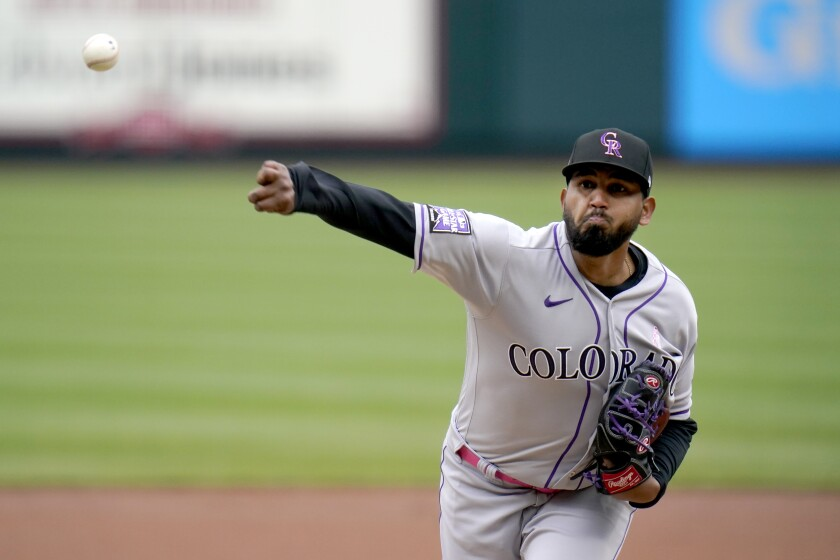Colorado Rockies starting pitcher German Marquez throws during the first inning of a baseball game against the St. Louis Cardinals Sunday, May 9, 2021, in St. Louis. (AP Photo/Jeff Roberson)