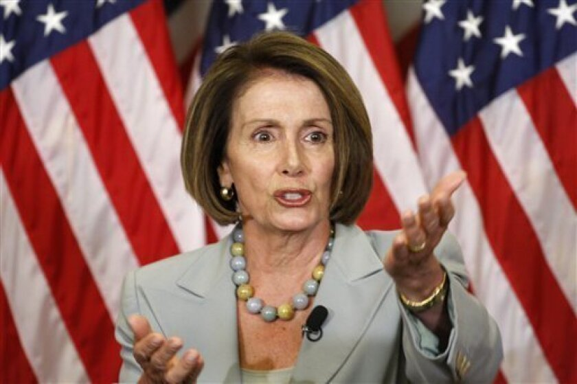 House Speaker Nancy Pelosi of Calif. gestures during a news conference on Capitol Hill in Washington, Thursday, Sept. 10, 2009. (AP Photo/Harry Hamburg)