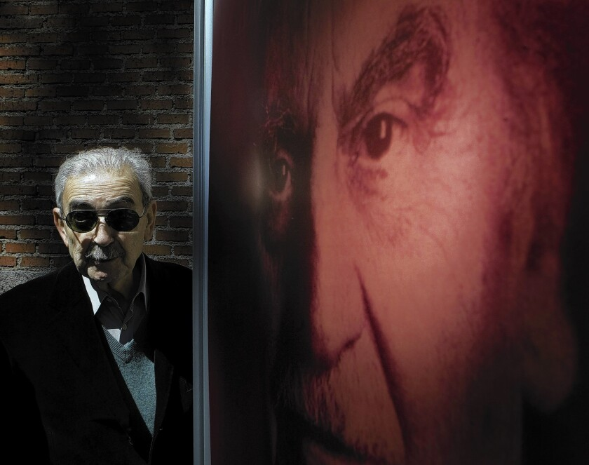 Poet Juan Gelman, shown at a 2008 exhibition in Madrid about Cervantes Prize winners, died Tuesday after battling leukemia.
