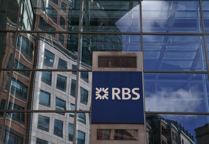 FILE- In this Aug. 4, 2015 file photo, the Royal Bank of Scotland logo is seen outside its headquarters, in the City of London. In an unscheduled trading update Wednesday, Jan. 27, 2016, the Royal Bank of Scotland said it is putting aside some 2 billion pounds ($2.8 billion) as the taxpayer-owned institution continues to tally the costs of misconduct and legal claims. (AP Photo/Alastair Grant, File)