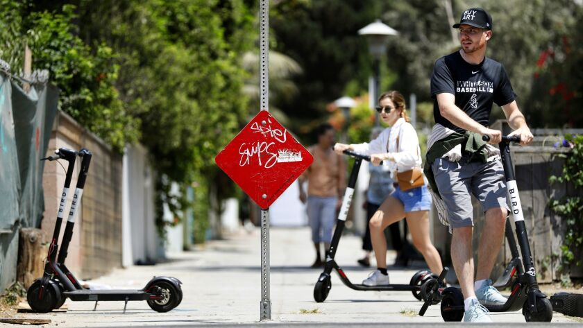 VENICE BEACH-CA-AUGUST 15, 2018: Electric scooter customers pick up scooters in Venice Beach on Wedn