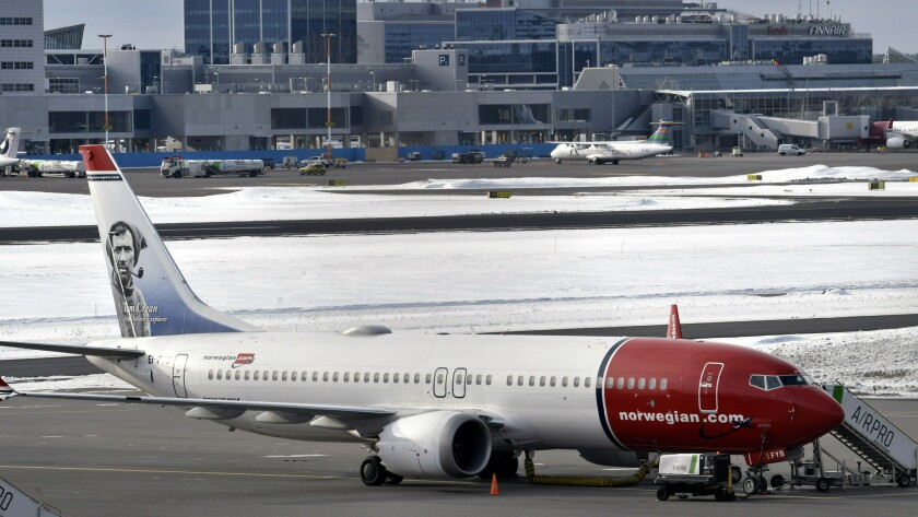 A grounded Boeing 737 MAX 8 passenger plane belonging to Norwegian airlines is parked on the tarmac