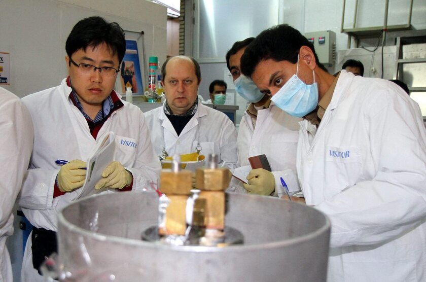 International inspectors check the enrichment process at a plant in Natanz, in central Iran, on the opening day of a six-month interim agreement under which Iran will limit its enrichment efforts while the international community eases punishing sanctions.