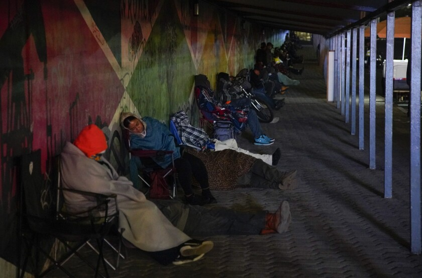 People have been sleeping in their cars at the Otay border to wait for the port of entry to open; it started happening after the hours of service of the border port of entry were reduced.