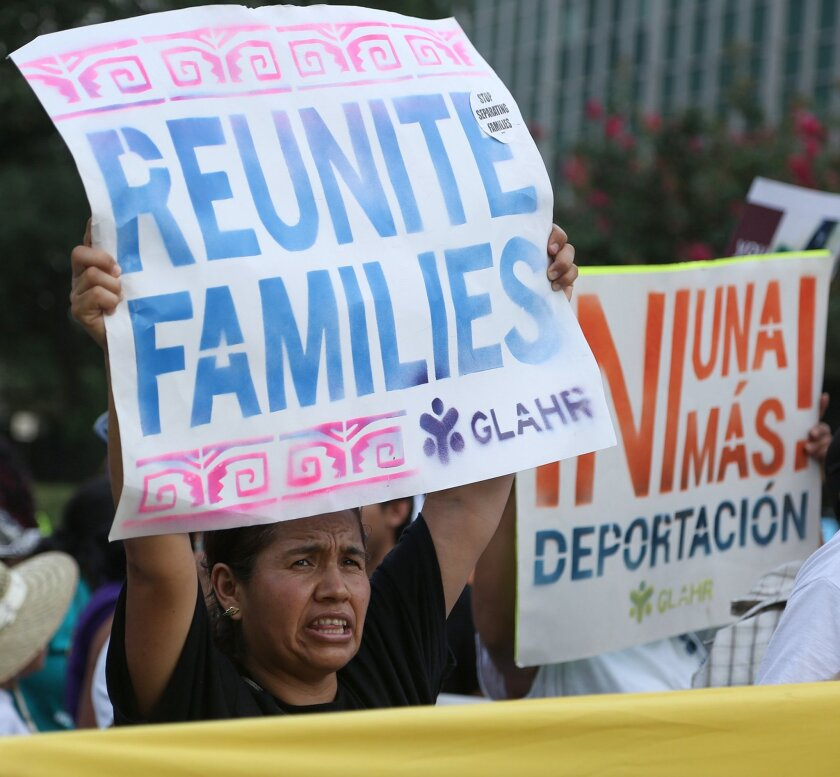 Immigration advocates rally outside the 5th U.S. Circuit Court of Appeals in New Orleans on Friday, July 10.