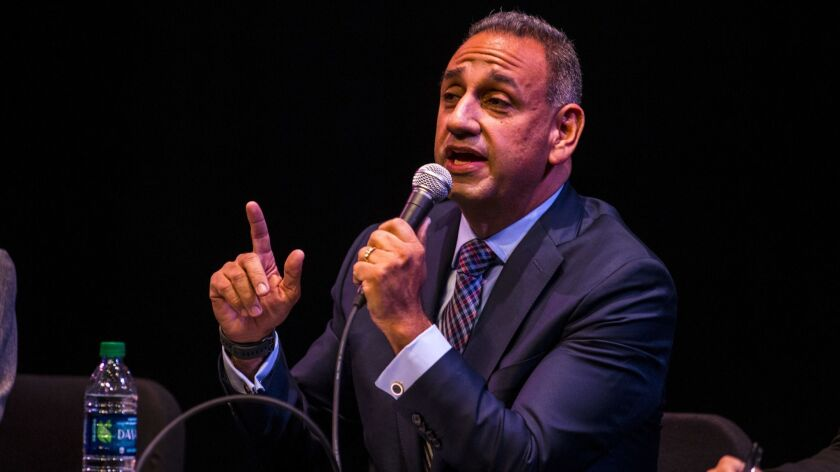 FULLERTON, CA - JANUARY 10: Candidate Gil Cisneros speaks during a forum at Fullerton College on Jan