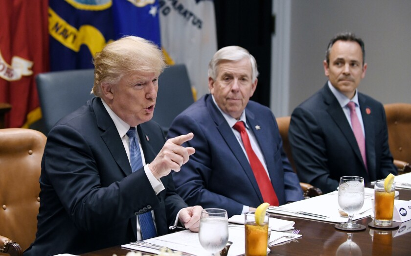 President Donald Trump flanked by Missouri Gov. Mike Parson and Kentucky Gov. Matt Bevin