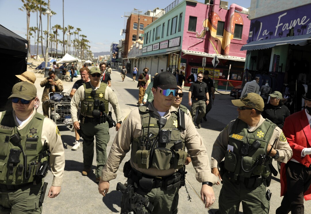 Sheriff's deputies patrol Ocean Front Walk.