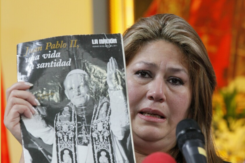 Costa Rican Floribeth Mora explains how she was suffering from a cerebral aneurism, and that doctors gave her a month to live, when she was inexplicably cured on May 1, 2011, the date of Pope John Paul II's beatification. The Vatican has ruled that Pope John Paul II is responsible for her mircale, which clears the way for his sainthood.