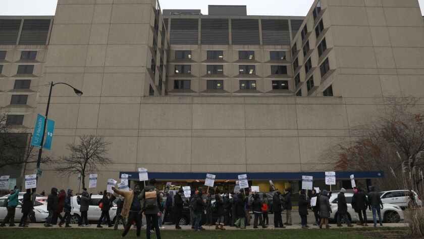 Licensed practical nurses at the University of Illinois Hospital and Clinics suspended their strike Monday, returning to work after the system's CEO agreed to participate in contract negotiations, the nurses said.