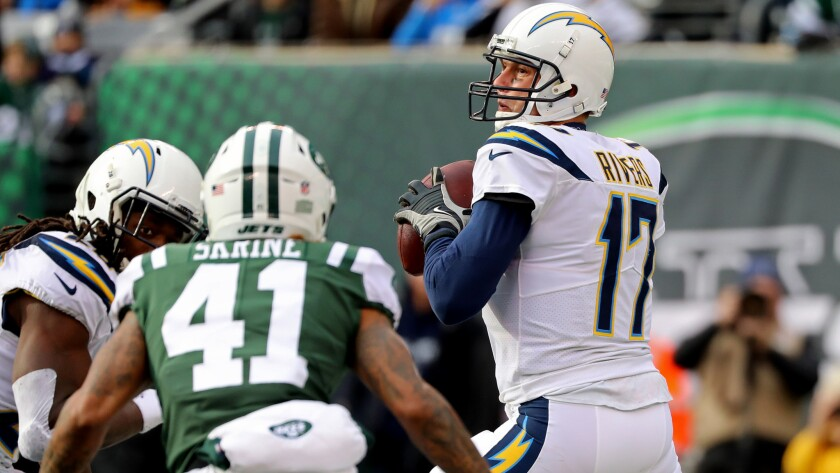 Chargers quarterback Philip Rivers tries to locate a receiver from the pocket during Sunday's game against the Jets.