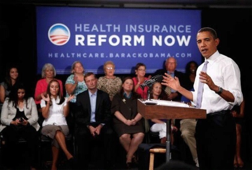 Obama is shown speaking during a town hall meeting on healthcare at the headquarters of the Democratic National Committee on Aug. 20, 2009.