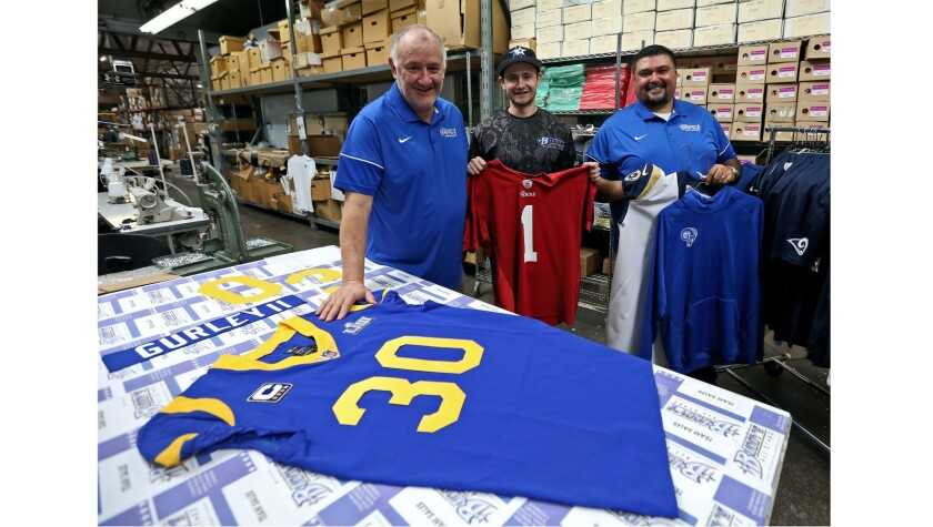 Buddy's All Stars Athletic Uniforms, Equipment, Lettering owner Louis Talamantes, left, with sublima