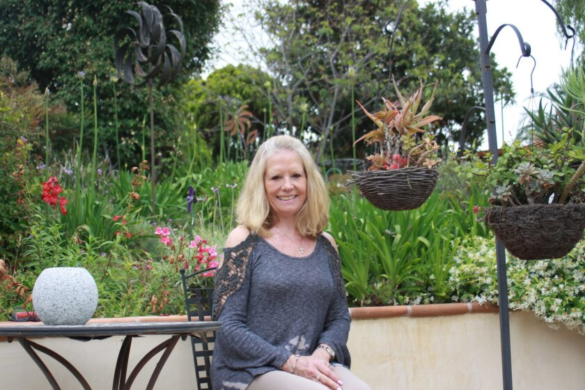 La Jolla painter Leah Higgins in her garden