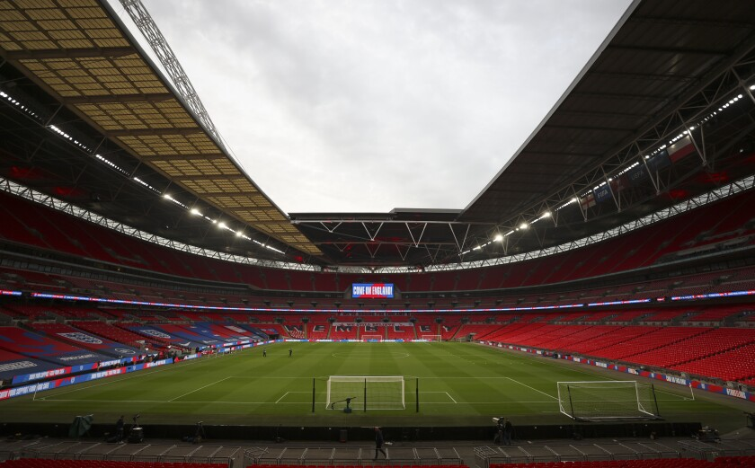 A view of an empty stadium before the World Cup 2022 group I qualifying soccer match between England and Poland at Wembley stadium in London, England, Wednesday, March 31, 2021. (Catherine Ivill, Pool via AP)
