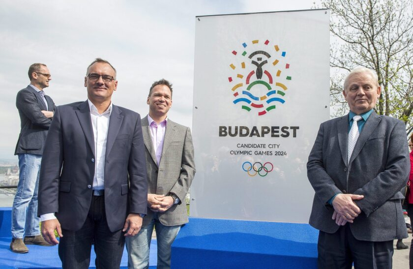 From left, Zsolt Borkai, president of the Hungarian Olympic Committee, Balazs Furjes, chairman of the Budapest 2024 bid, and Budapest Mayor Istvan Tarlos stand in front of the logo of host city candidate Budapest for the 2024 Olympics on Thursday.