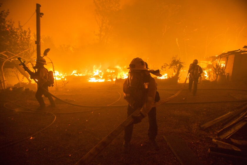 Firefighters battle the Lake Hughes fire in Angeles National Forest.