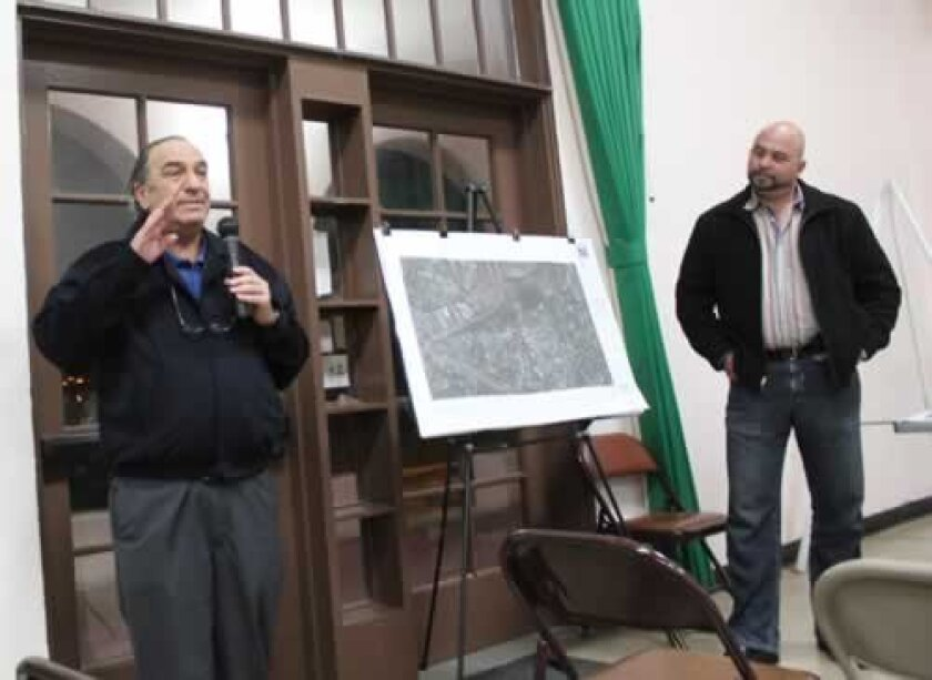 Caminito Bello resident Irwin Belcher states his opposition to a project on Costebelle Way that is below his home and adjacent Pottery Canyon Park. Project architect Claude Anthony Marengo listens, preparing to respond. Pat Sherman