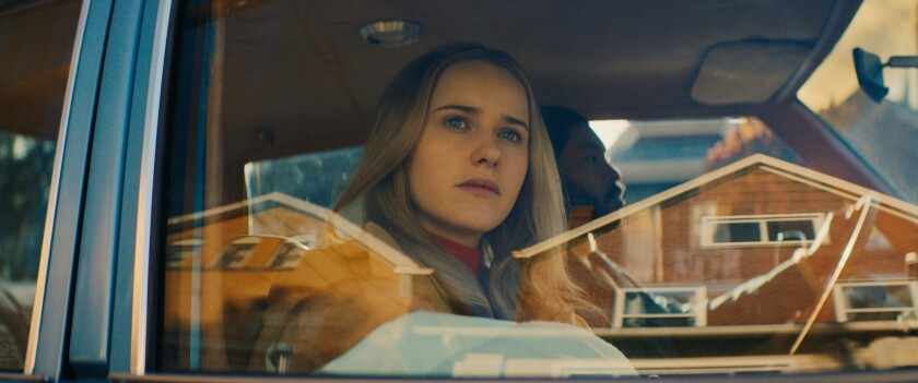 """Rachel Brosnahan looks out through a car window in the movie """"I'm Your Woman."""""""