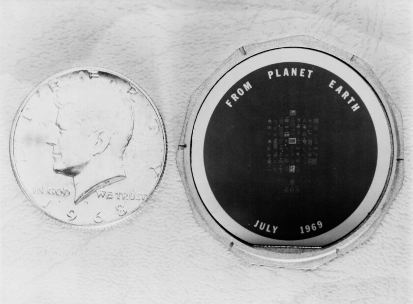 The silicon disc left on the moon by Apollo 11, containing greetings and messages from world leaders. - Original Credit: NASA