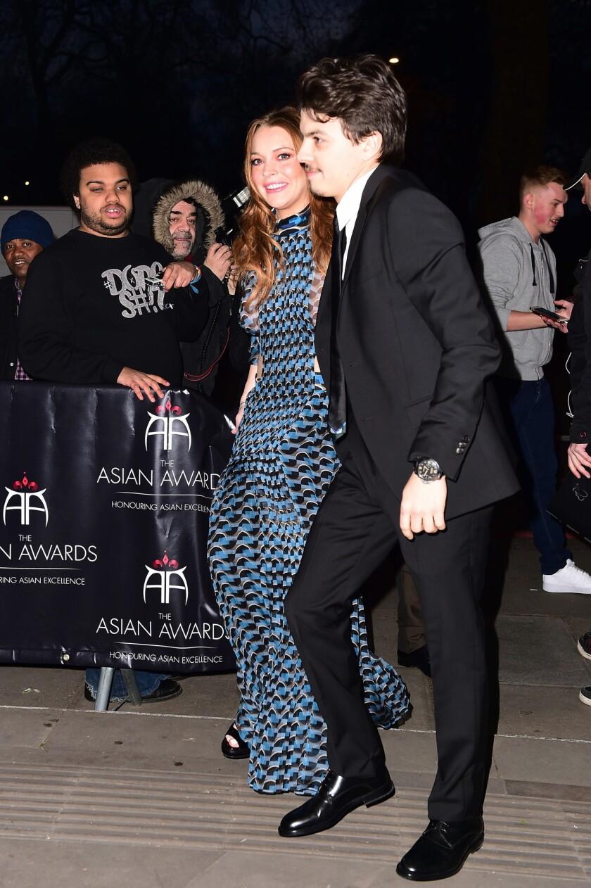 Lindsay Lohan and Egor Tarabasov arrive at the 2016 British Asian Awards in London on April 8.