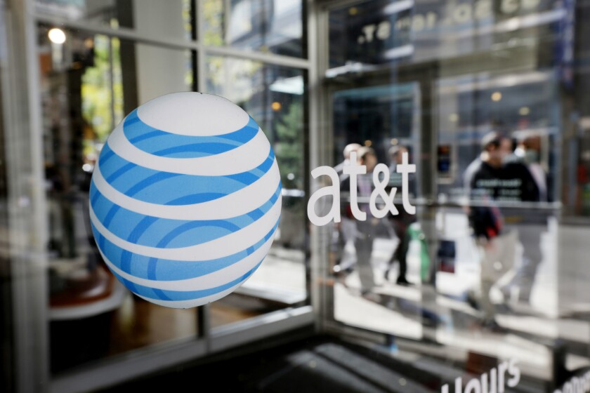 File: AT&T announced Wednesday, Aug. 17, 2016, that the company is joining Verizon in raising the prices of some of its data plans in what the wireless company terms a simplification.