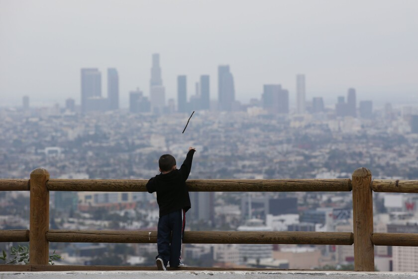 The view from the Hollywood Bowl overlook on Wednesday shows gray skies enveloping downtown Los Angeles.