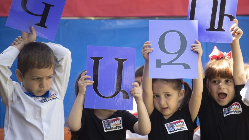 Los Angeles Times reporter Esmeralda Bermudez is raising her daughter to be trilingual. The 5-year-old girl, second from right, sang songs and recited poems in Armenian at her Armenian school's end-of-the-year celebration.