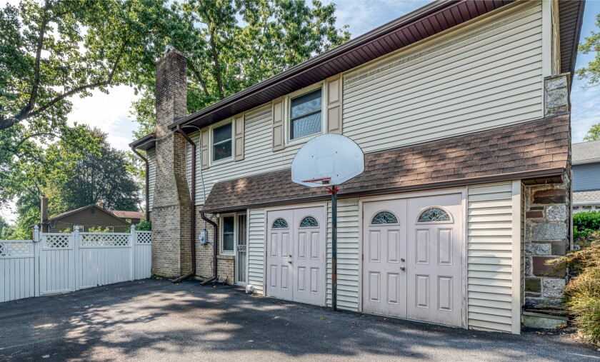 The Colonial-style Philadelphia home comes with Kobe Bryant's original hoop, according to the listing agent.