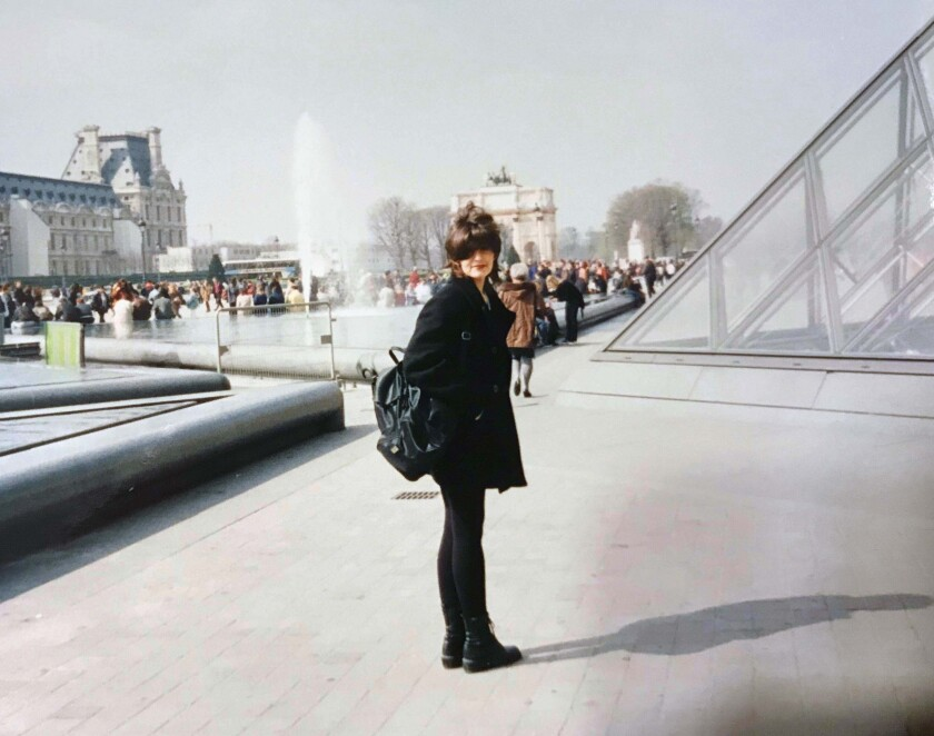 A woman standing outside the Louvre