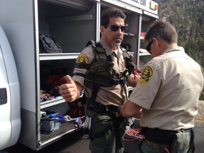 Los Angeles County Sheriff's Department Reserve Chief Mike Leum helps Sheriff Reserve Lt. Lou Ferrigno, who played the Hulk on TV, prepare for Montrose Search and Rescue Team training on Sunday, Nov. 10, 2013.