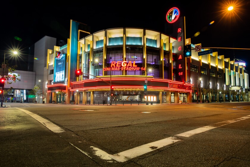 The Regal theater at LA Live is lit up and empty on March 21.